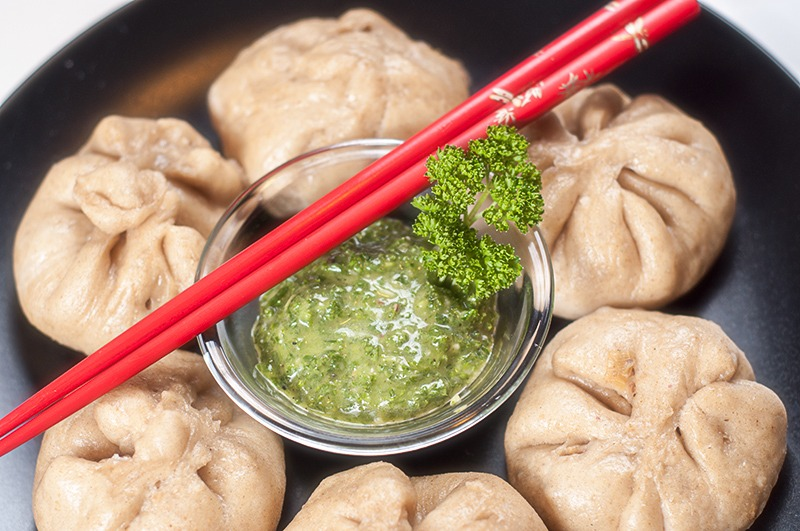 baozi with cabbage stuffing and chimichurri sauce